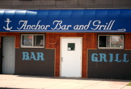 front of restaurant with blue awning that reads Anchor Bar & Grill
